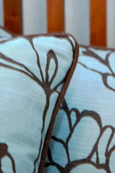 Elegant interior, soft and natural shades, blue patterned cushions