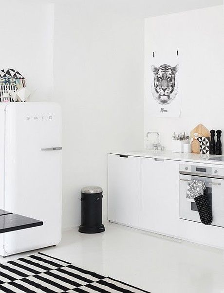 A sleek black and white kitchen with a SMEG fridge #interiors #kitchen #cool #contemporary