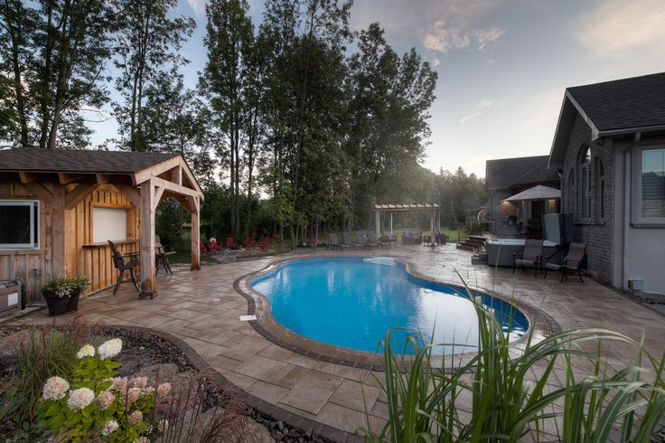 Finished with a rough cut timber frame cabana, wet bar, flat screen TV, and outdoor shower. Landscaping includes unilock pavers, natural stone, pool coping and a pergola