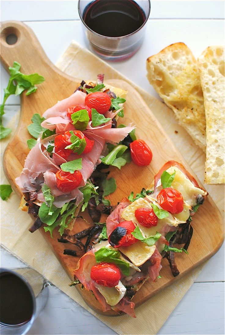 Toasted Ciabatta with Prosciutto, Caramelized Onions, Arugula, and Brie