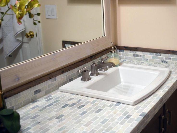 A Builderu0027s Minimum Bathroom Gets A Maximum Makeover. Bathroom Lighting  FixturesTile CountertopsMosaic ...