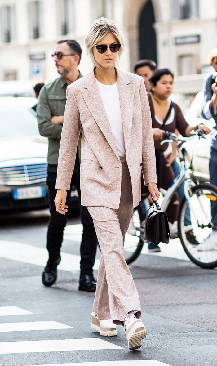 A pale pink suit is paired with Stella McCartney platforms and a black top-handle bag