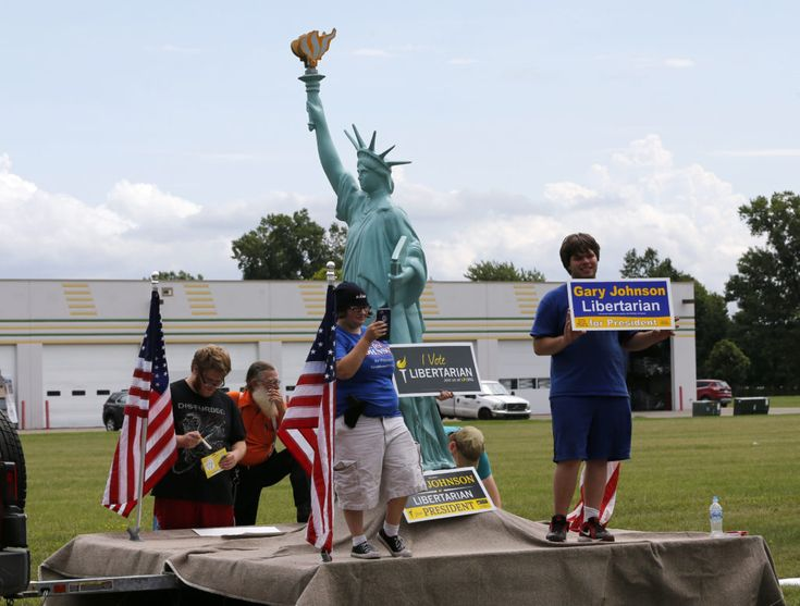 Supporters of Libertarian third-party candidate Gary Johnson gather outside a rally for US Republican presidential candidate Donald Trump at the Summit Sports and Ice Complex on August 19, 2016 in  Diamondale, Michigan.