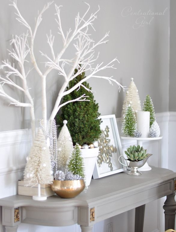 White Christmas decor via Centsational Girl Group items on cake stand - love the silver metallic table: Christmas Tree Stand, Christmas Decorations, Small Christmas Tree, Cake Stands, Christmas Table, White Christmas Tree, White Christmas Decoration