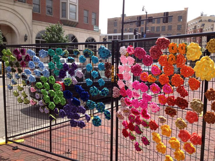 Local crafters yarnbomb fencing in Chicago.