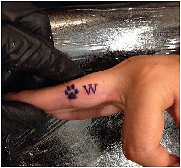 #TattooSymbolism #Tattoos Dog Paw and W Font Finger Tattoo Design, click for mor…