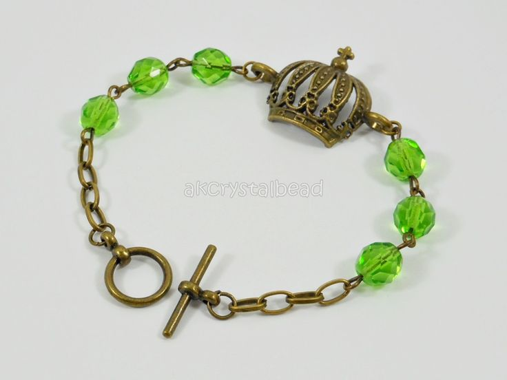 Bronze crown and green Czech fire polished bead bracelet. FSM0082