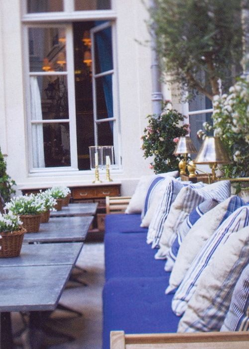 Zinc tables and ticking pillows.
