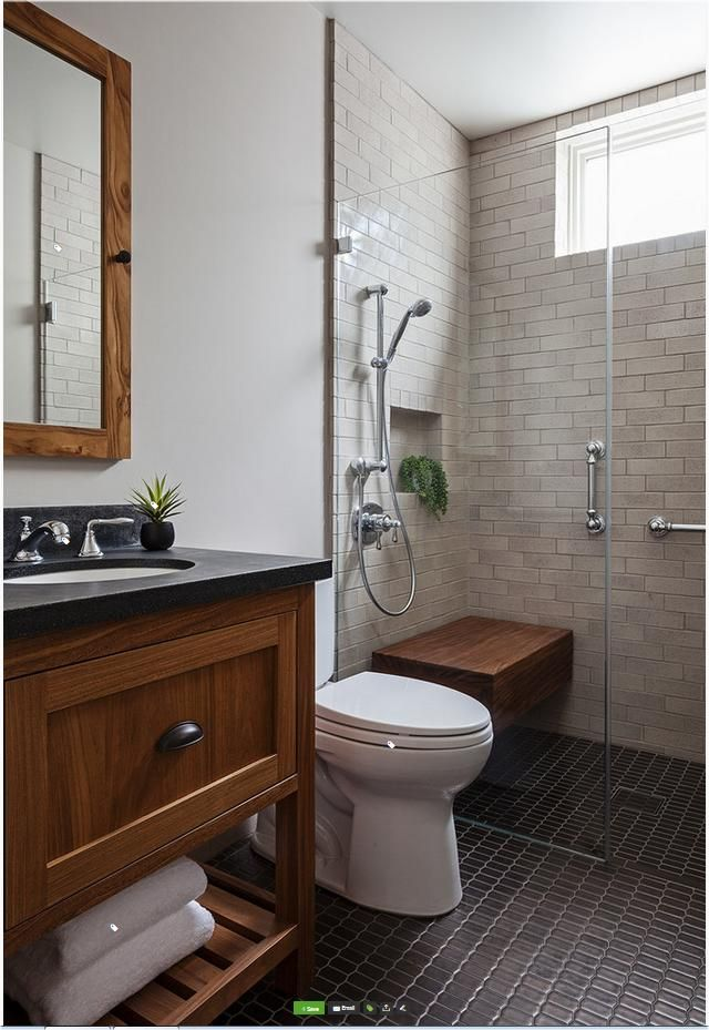 1914 Craftsman revival on Houzz.  Notice how the Shower walls and walls blend, make the room look larger.  Darker curbless floor grounds the room.