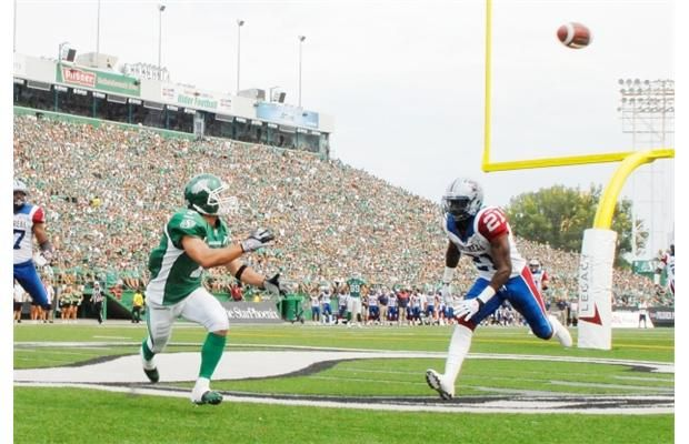 Saskatchewan Roughriders slotback Weston Dressler (#7) receives for a touchdown while Montreal Alouettes linebacker Mike Edem (#21) is caught behind the play during a game held at Mosaic Stadium in Regina, Sask. on Saturday Aug. 17, 2013.