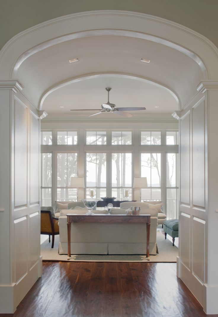 Entry into living room window wall arched opening wood for Entryway into living room ideas
