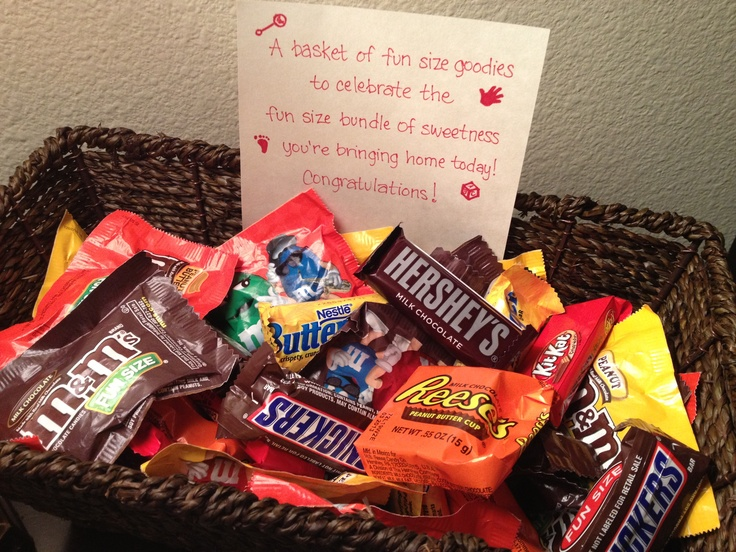 "A simple gift for parents bringing home a new baby: a basket of fun size candy. The note says, ""A basket of fun size goodies to celebrate the fun size bundle of sweetness you're bringing home today! Congratulations!"" You could decorate the basket or set it in the middle of a pile of baby sized balloons (water balloons) to make it more fun."