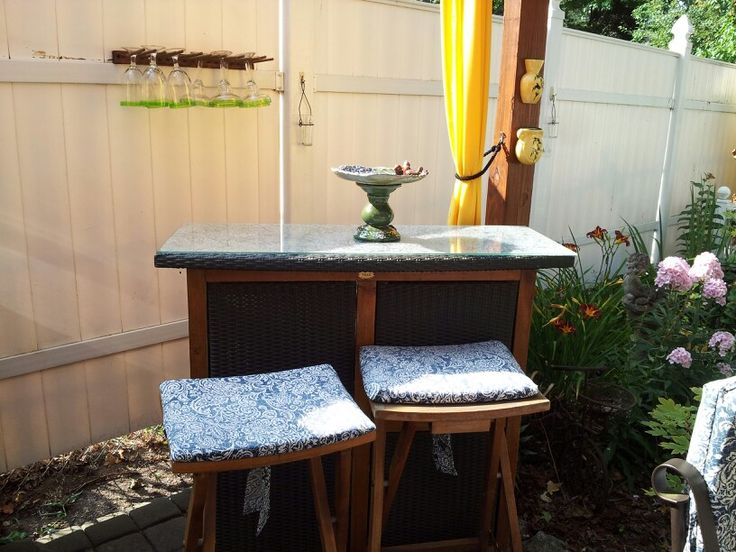 An outdoor bar is more than a place to mix drinks. It offers extra outdoor storage, extra seating, a buffet table and is a nice focal point in a small yard.
