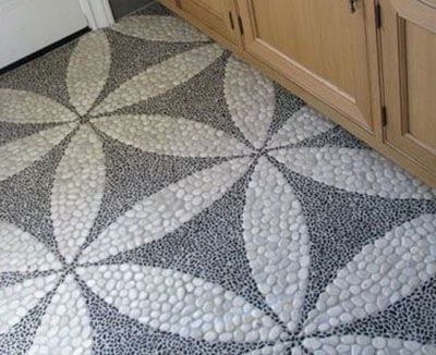 I could have pinned every picture on this page! Pebble mosaic flower of life kitchen floor wins it though!