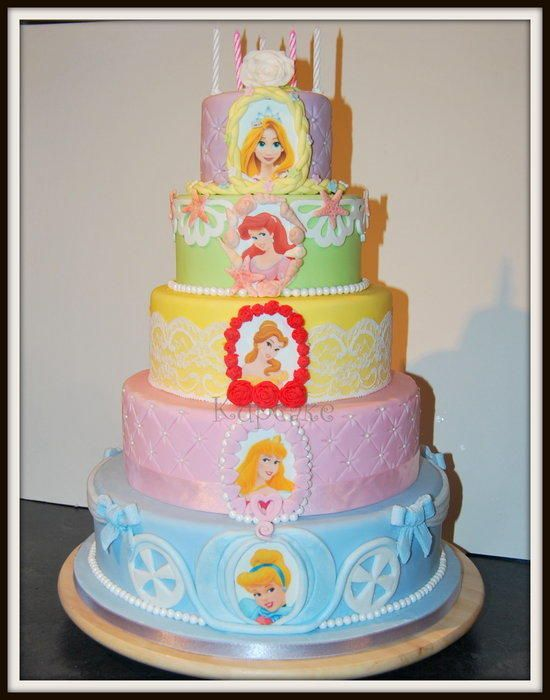My daughter decided she wanted a disney princess cake but she wanted each princess on her own cake! We designed this togther and she even helped with some of it