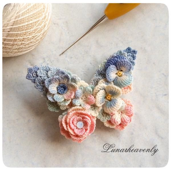Tiny crochet flowers make a butterfly brooch