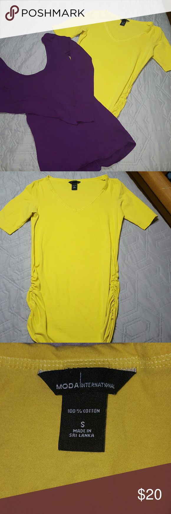 Victoria's Sectret Moda International Tunics Bundle of 2 tunics.  Both are size small. The yellow has a mid sleeve and side rushing.  The purple is a long sleeve, scoop neck and rushing along the back seem of top. Gently used and in great condition. Victoria's Secret Tops Tunics