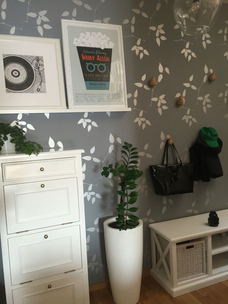 Entry hall, Warsaw features Flugger wallpaper, funny Normann Copenhagen hangers and some casual art... #reneesinteriordesign #entryhall #entrance #entry #coathangers #posters