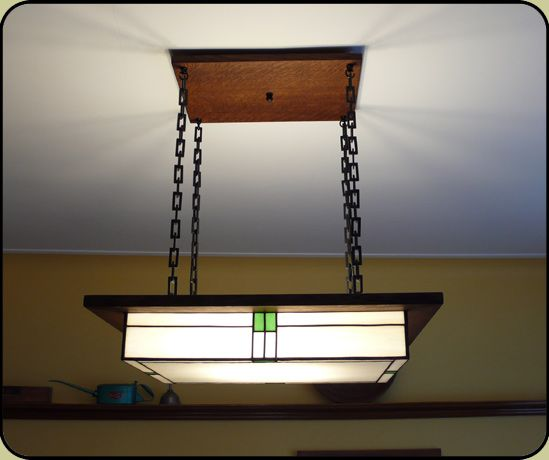 Dining Room With Large Mission Style Light