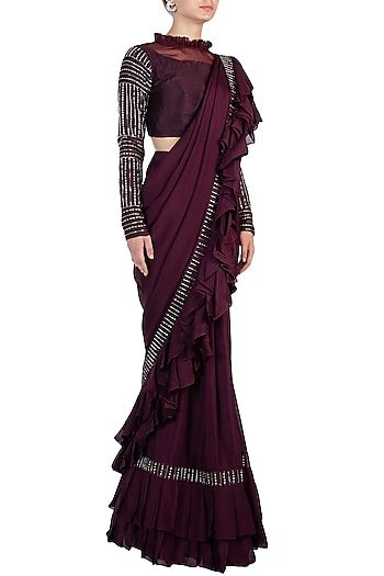 109898d13a ... a wine two layered ruffled saree in crepe base with 3D rose gold  handwork embroidery. It is paired with matching full sleeves blouse in raw  silk base.