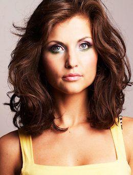 Long brunette wavy hairstyle.