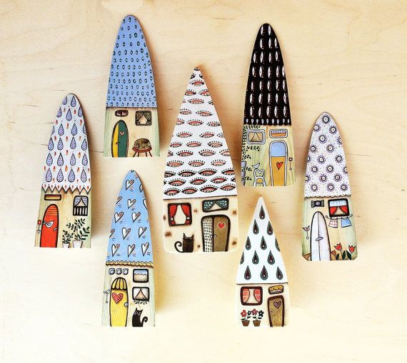 Wooden houses, hand painted by acrylic paint. A final coat of varnish protects the color. Measure: height 20cm approx all pcs have 3,5cm thick by Viljocenne--Italy.