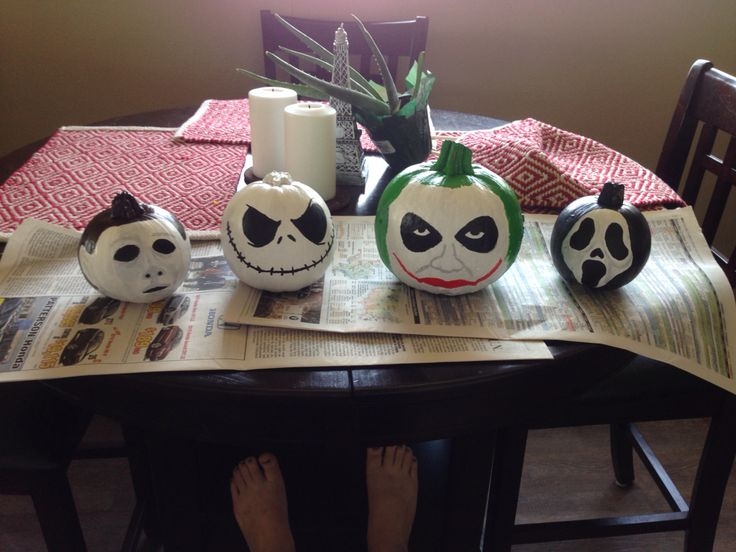 Michael Myers, Jack Skellington, The Joker, and Scream painted pumpkins
