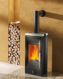 RIKA | Woodburning stove | Vitra Passive House.  The stove should be as small as possible as the heating power tends to be much too high in very efficient houses.