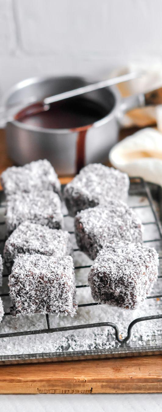Lamingtons - a vanilla sponge dipped in chocolate and coated in coconut #lamingtons #australia #australiaday