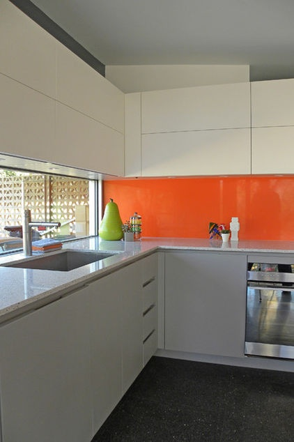 this orange backsplash was a bold choice that paid off i love color