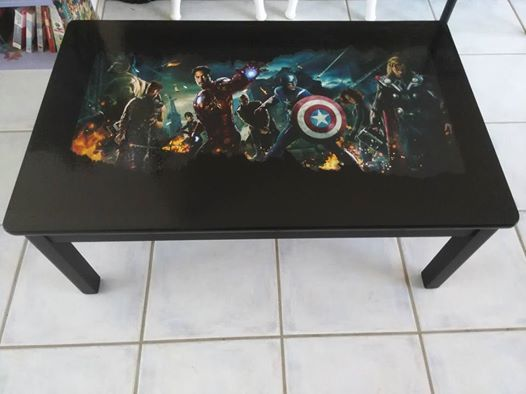 A matt black coffee table with Avengers Movie decal then high gloss finish