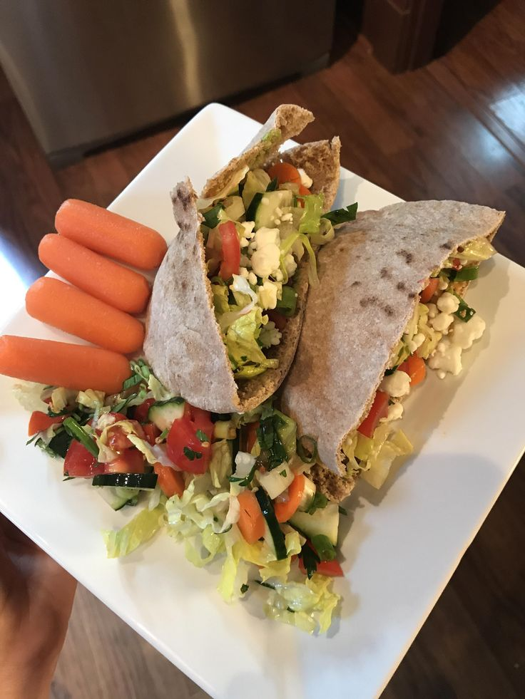 Tabouli inspired salad with a smear of homemade guacamole and goat cheese in a whole wheat pita- 260calories. #goodnutrition #physicalactivity #goodfood #vegetables #JuicePlus #healthymeal #healthyfood #healthy #health #exercise #eatclean