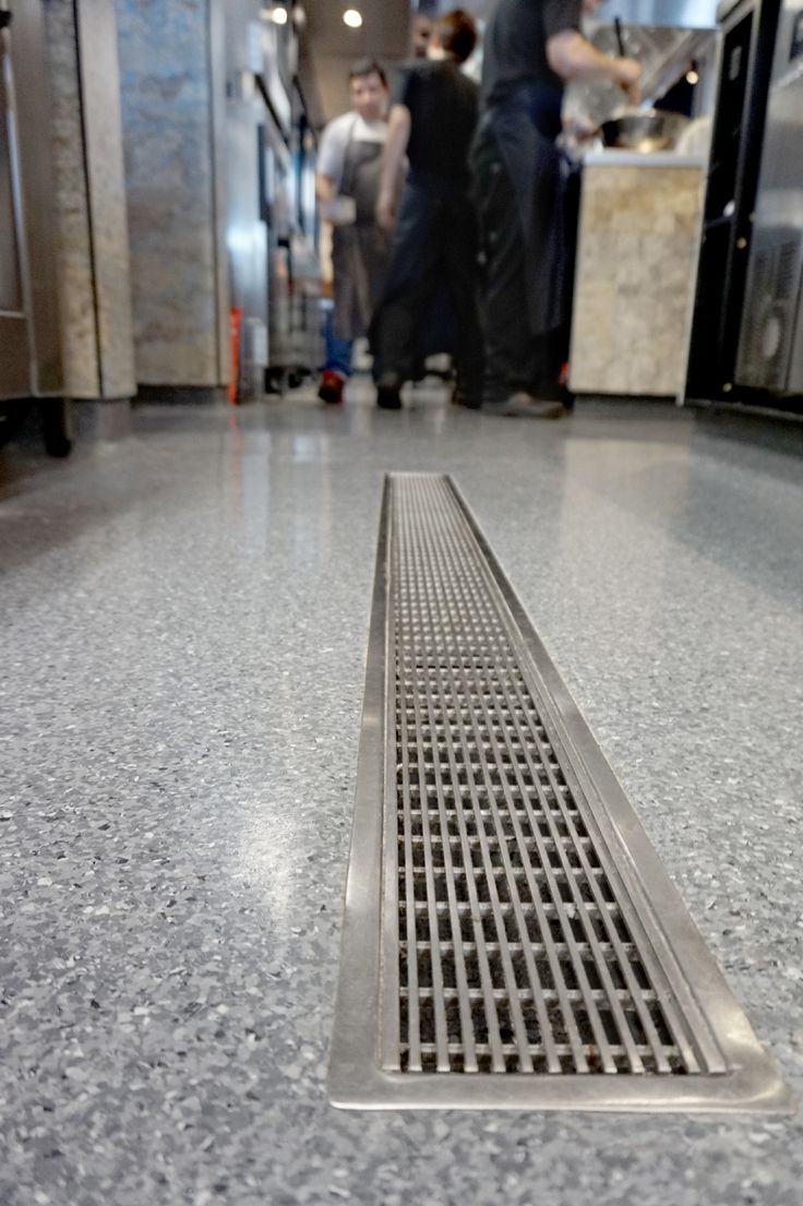 Allproof VCC channel for commercial kitchen drainage solutions with Wedge Wire R11 rated slip resistant grate, perfect for a busy restaurant kitchen with vinyl flooring.