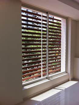 Ventanas Corredizas: Ventanas de estilo  por Productos Cristalum  https://www.homify.com.mx/libros_de_ideas/2324404/32-disenos-de-ventanas-que-haran-que-tu-casa-se-vea-fantastica
