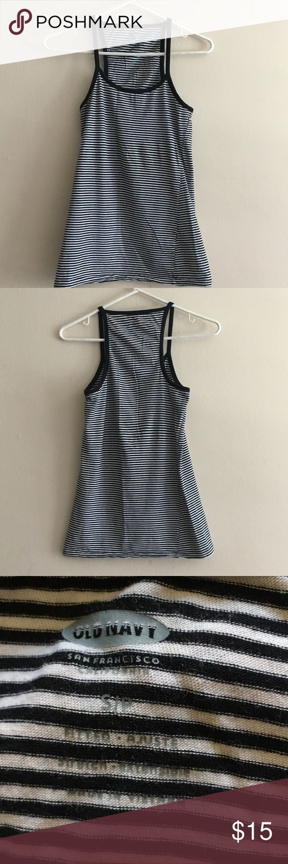 """Old Navy Striped tank top Size small Old Navy Striped tank top Size small This is a simple, classic, versatile tank top. You can wear this under a button down shirt or a jean jacket for a fun look.  Measurements Length 25.5"""" Bust 30"""" with stretch to 36""""  Opening at bottom: 33"""" with stretch up to 44""""  Preloved, comes from a smoke-free pet-free home. Old Navy Tops Tank Tops"""