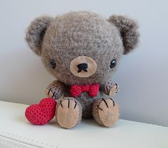 This sweet fuzzy teddy with his dapper bowtie is perfect for your loved ones! His fuzziness is achieved by brushing the yarn with a dog slicker brush.