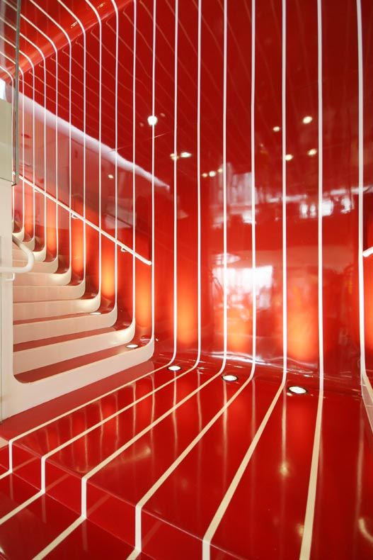 Another shot of this clever combination of bright red and white lines, here it plays off the steps and stairs and continues on walls and ceilings for more dynamism. Love it.