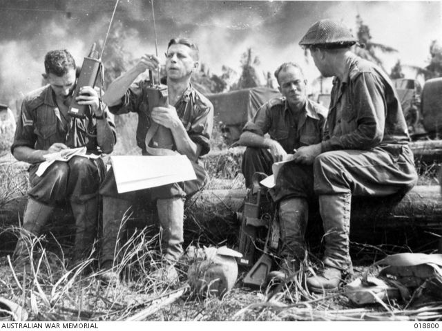 Balikpapan, Dutch Borneo. 27 June 1945. Beachhead established during the landing by Australian troops, signallers with walkie-talkies keep communications intact.