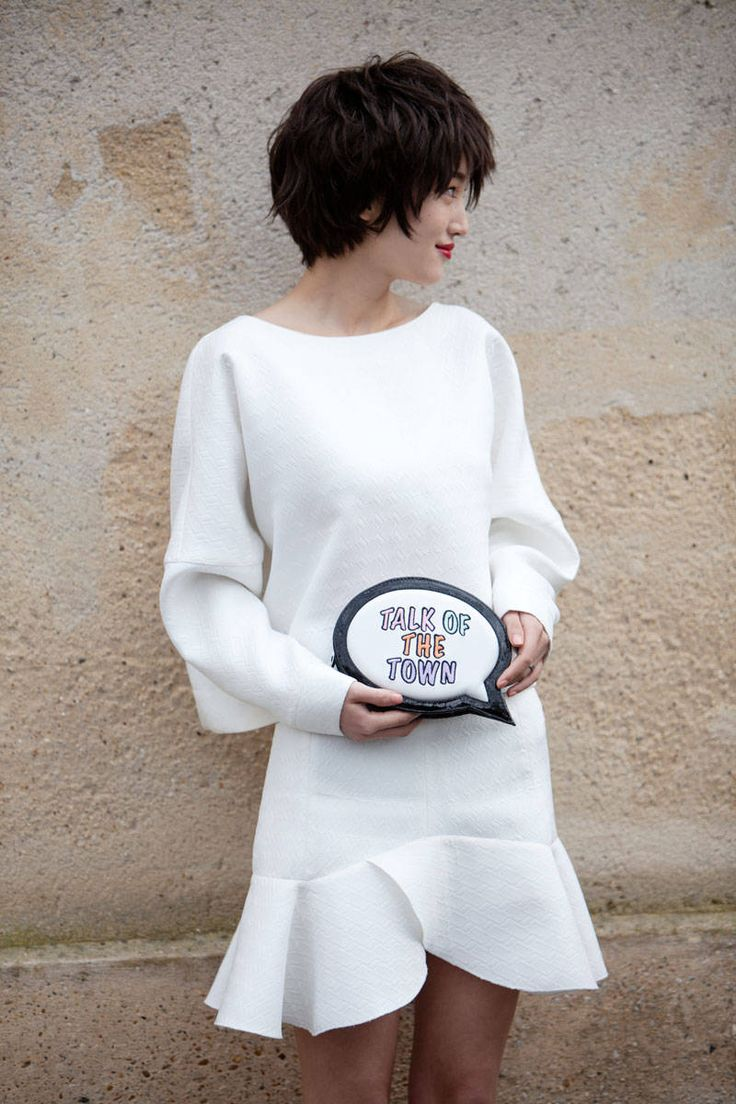 Street style - White dress - cute talk of the town clutch - textured layered short hairstyle - Paris Fashion Week 2014