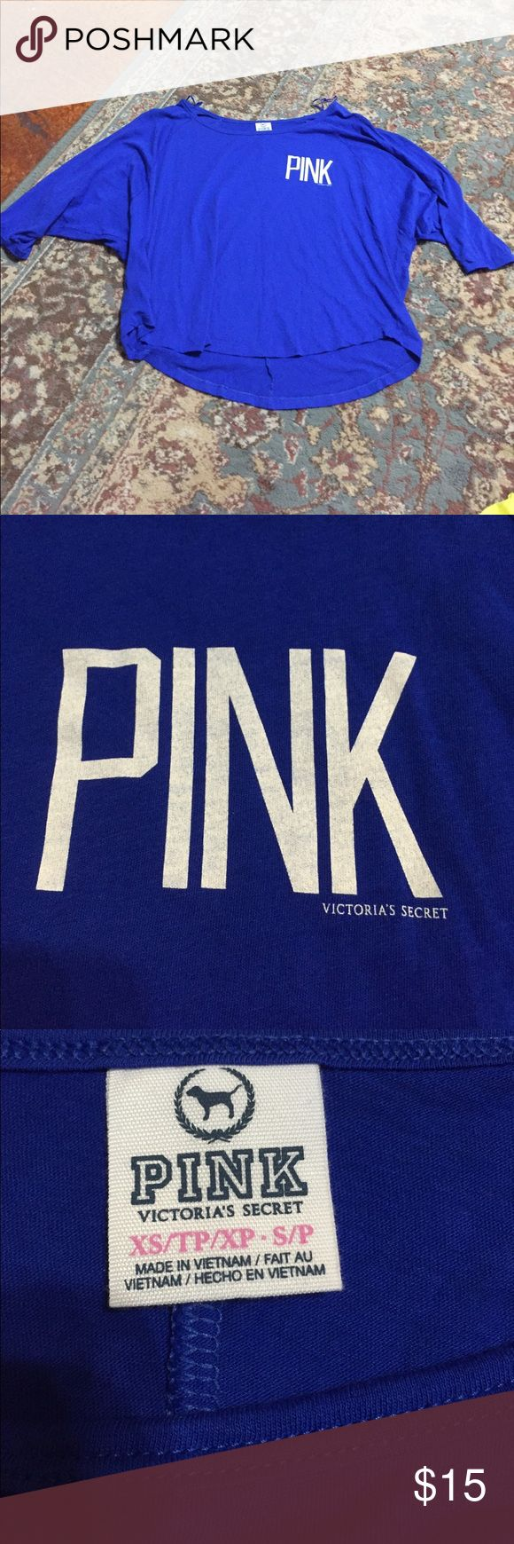 VS PINK blue slouchy loose top Like new condition :) royal blue color with white pink logo on it. The sleeves are loose at the base but then tighter on your arm-they go to slightly above elbow length. PINK Victoria's Secret Tops Tees - Short Sleeve
