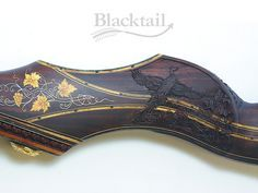 Hand-carved, hand engraved Legacy series recurve bow by Blacktail Bow Company, LLC