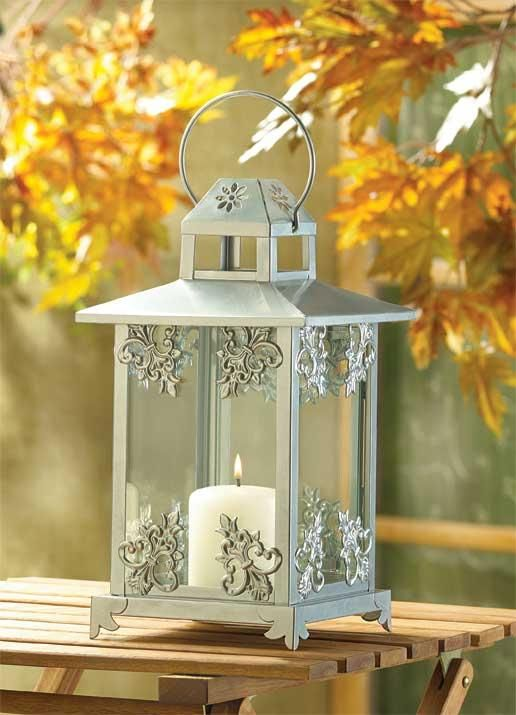 Gleaming Silver Finish And Graceful Scrollwork Lend Old Fashioned Opulence To A Classic Candle Lantern An Elegant Decoration Enjoy Night Day