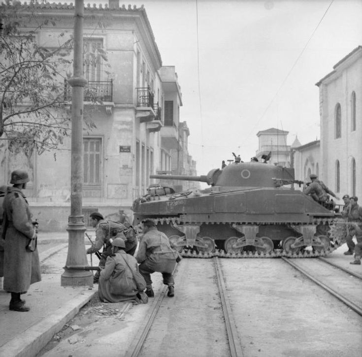 Battle of Athens, Greece, December 1944: Paras of the 2/5th Scottish Parachute Battalion, supported by tank, battle communist insurgents in the streets. With them are Greek gendarmes, one of whom, on the left, is wearing a German helmet.