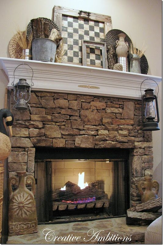 Rustic Winter Mantel..love the framed checkerboard (could even be functional w/ wooden checkers nearby)..also the old lanterns..