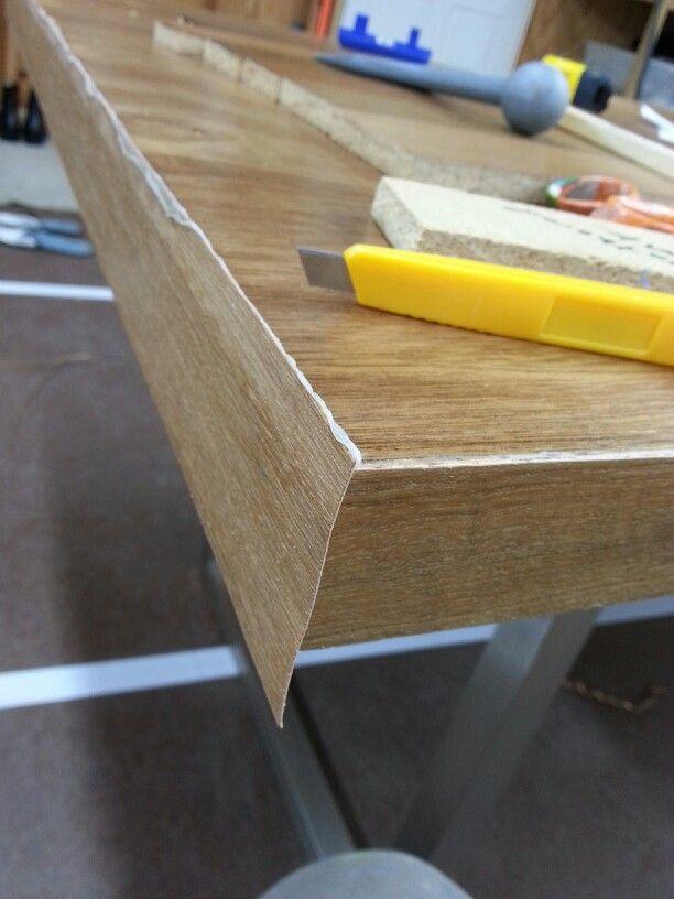 DIY DESK 2.0: Here I am applying the teak veneer edges to the desk on