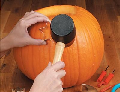 Decorate pumpkins using cookie cutters