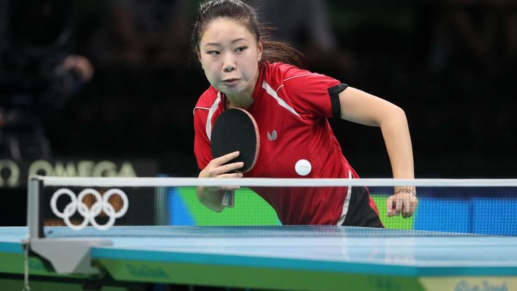 2016-08-08-rio-olympics-lily-zhang:    Lily Zhang of the United States competes against Hyowon Suh of South Korea during women's singles table tennis play in the Rio 2016 Summer Olympic Games at Riocentro - Pavilion 3.