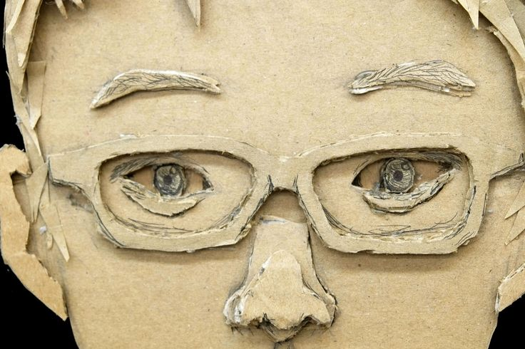 20 Cardboard Portraits by 12th Graders.