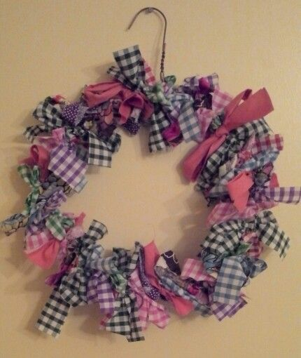 Great way to use up scrap fabrics on a coat hanger bent into a circle. Idea would be great for christmas wreaths.