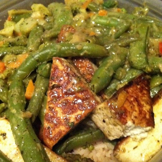 trader joe's thai green curry simmer sauce over vegetables and tofu
